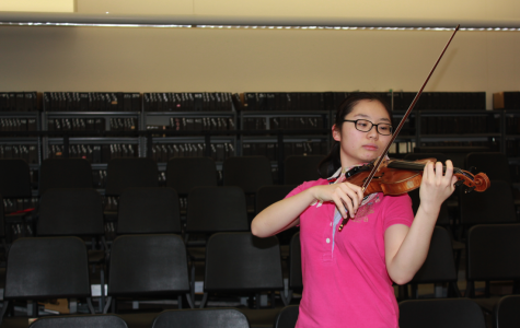 Senior Momo Wong practices violin and piano at the New England Conservatory Preparatory School. (Photo by Sabine Shaughnessy)