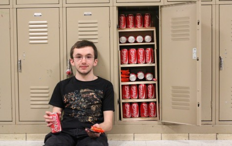 Junior Phil Jacobson stores candy bars and soda cans in his third floor locker. (Photo by Branden Miles)