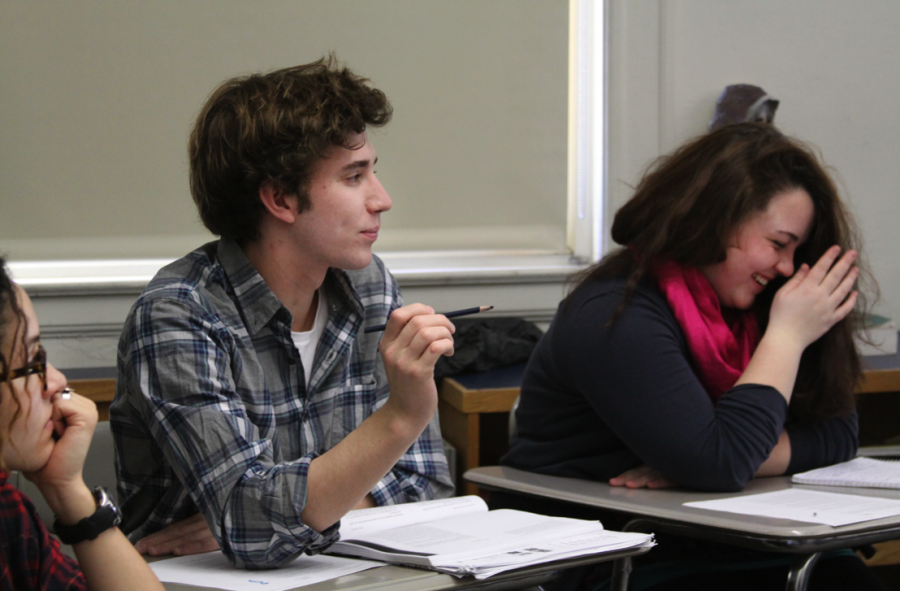 Senior Jeremy Stanhope (left), a mainstream student, and sophomore Jordan Underwood (right), of SWS, enjoy SWS English class. (Photo by Matthew Goroff)