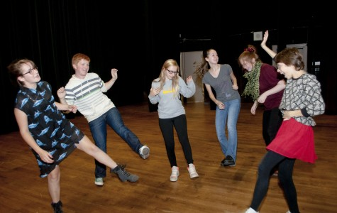 Cast members energetically warm up before rehearsing for The Winter's Tale. Photo by Ethan Roubenoff.