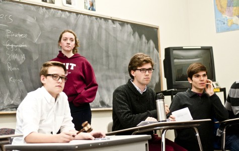 Sophomores Edward Hardebeck and Camille Whyte and seniors Henry Shreffler and Diego Fernandez-Pages at MUN. Photo by Ethan Roubenoff.