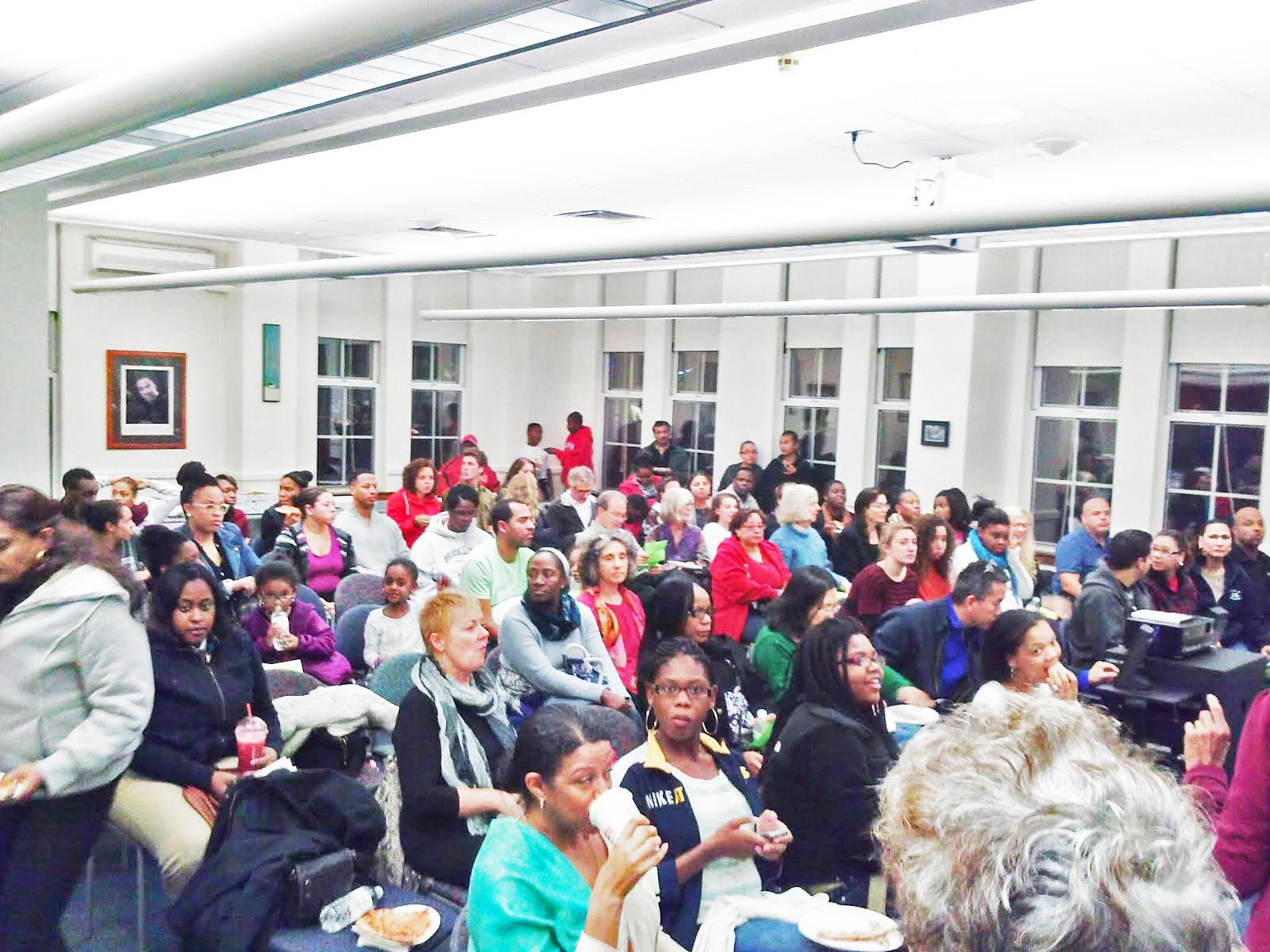 A crowd consisting primarily of METCO families gathers in the Martin Luther King Jr. Room for a monthly Race Reels event. (Photo by Destiny David).