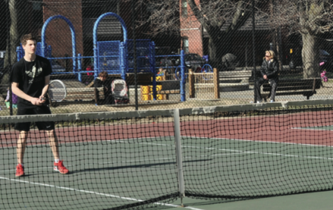 Freshman Josh Caplan practices at the Waldstein Park tennis courts. Renovations threaten the teams' use of the courts. Photo by Ethan Roubenoff.