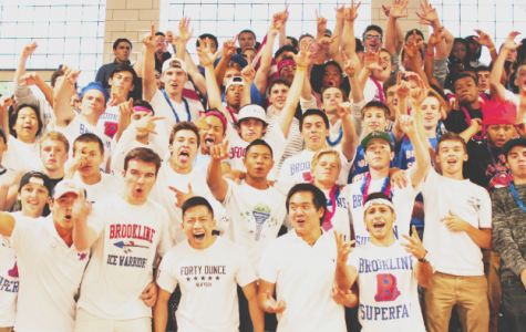 Brookline High School students wear Brookline Superfans shirts at a recent girls varsity volleyball game. The Superfans serve the sports community by bolstering attendance at athletic events.