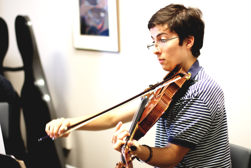 Photo by Sofia Tong Senior Nicholas Gallitano practices the viola. Gallitano finds enjoyment in sharing his talent in music.
