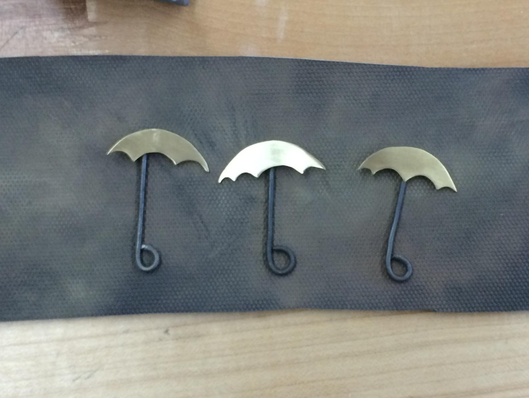Students can be as creative as they want with their pieces.  Above are some miniature umbrella pendants in process.