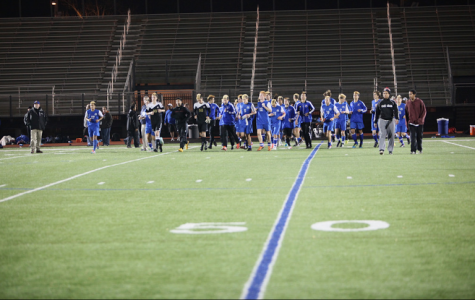The boys soccer team jogs off the field for the last time after a 1-0 loss to Acton-Boxborough in the Division I North semifinals at Manning Stadium. PHOTO BY HOLLOWAY MCCANDLESS