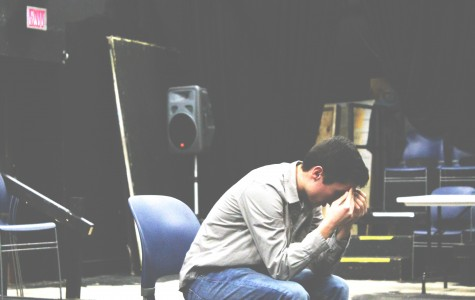 Photo by Hannah Lowenstein. Junior Trevor LaSalvia rehearses a scene from the play.  He said the serious subject matter forces the actors to put themselves into their characters' shoes.