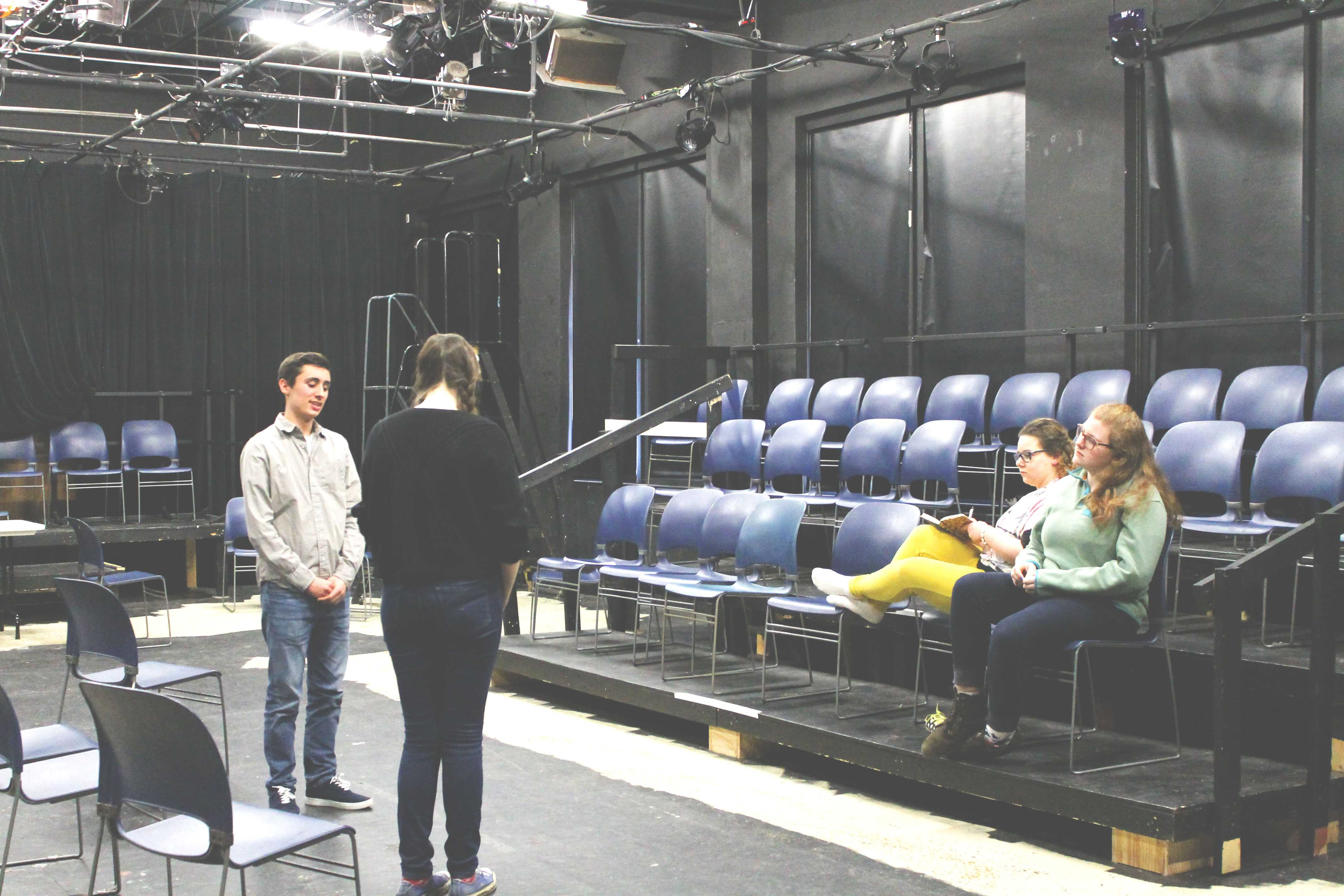 Photo by Hannah Lowenstein. Junior Trevor LaSalvia and freshman Sarah Grousta block a scene from the play. Writer and director senior Noa Goihberg said she tries to include the other actors' opinions so that the play can approach the topic of mental illness from all angles.