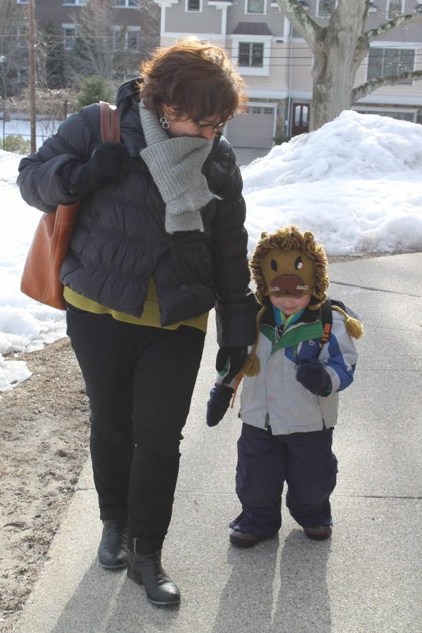 English teacher Amy Morrissey picks up her son Gabriel from preschool. Morrissey is one of two teachers who were denied part time status this year. Interviews with nine teachers as well as former and present school and town administrators found that the process of deciding part time status is often confusing, non-linear and opaque. Photo by Sofia Tong.