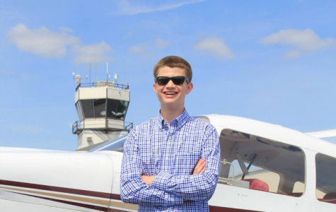 Senior Phil Mahler poses by an airplane. Mahler says his experience working as a teenager has taught him important lessons. PHOTO PROVIDED BY PHIL MAHLER.