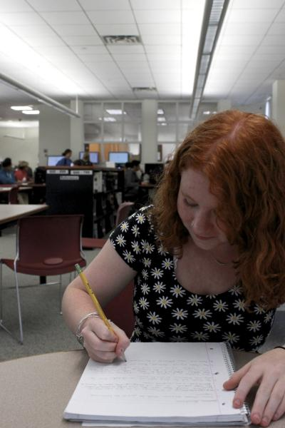 Lily Harris works on a creative writing assignment. Photo by Petra Huang for the Sagamore.