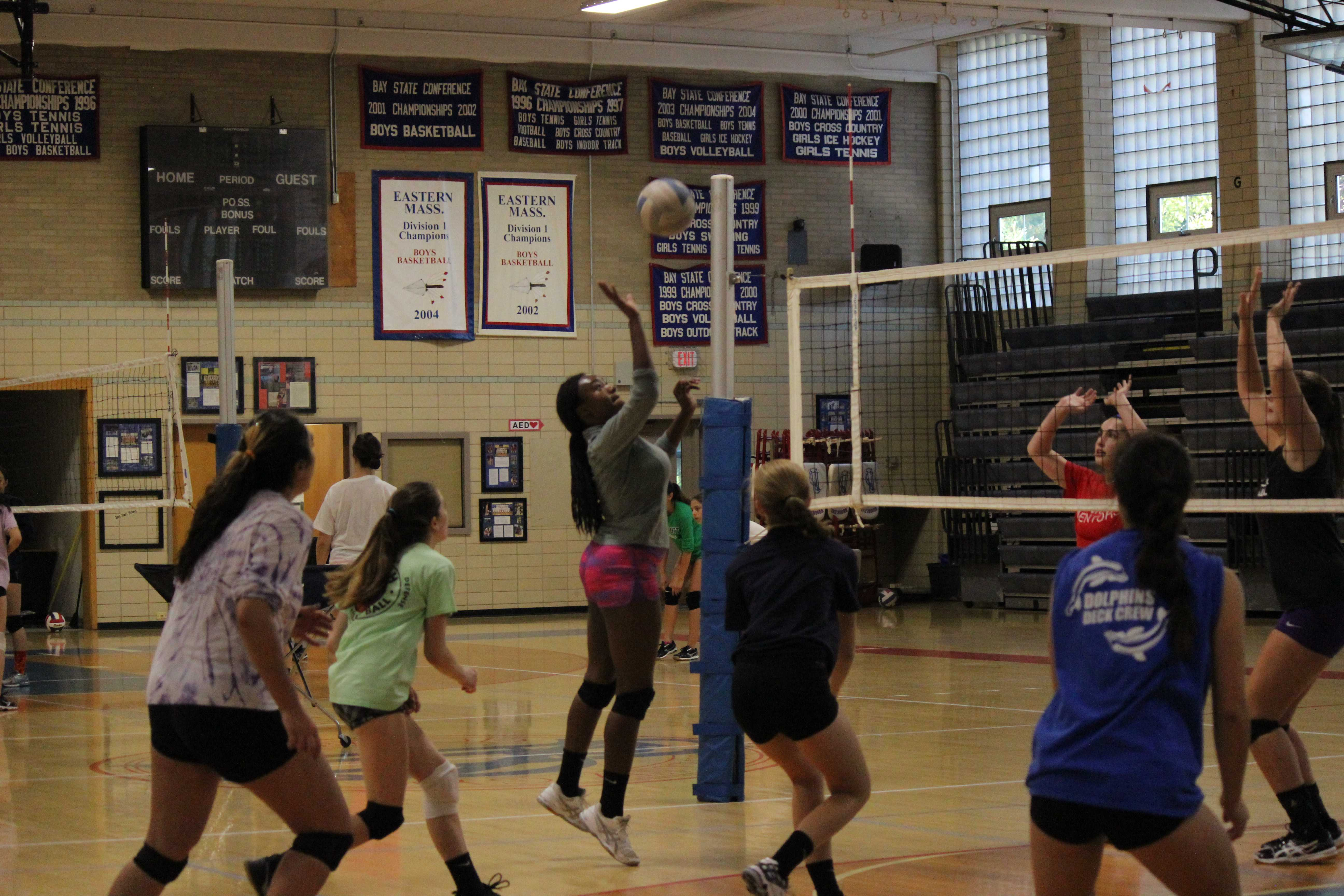 Junior Ndanu Mutsiya hits a ball during a girls volleyball practice in the Schluntz Gymnasium. PETRA HUANG FOR THE SAGAMORE
