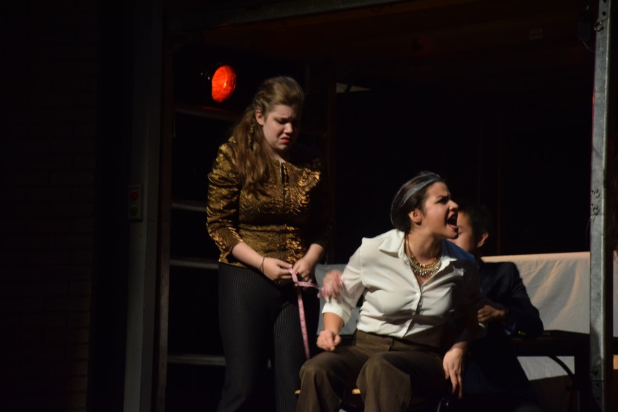 Left to Right: Regan's Entourage (senior Rianna Cranberg), Gloucester (senior Maeve Forti), and Henchman (junior Max Murphy) perform at a dress rehearsal on Tuesday, Nov. 3 the day before Lear opened. Sam Klein / Sagamore Staff