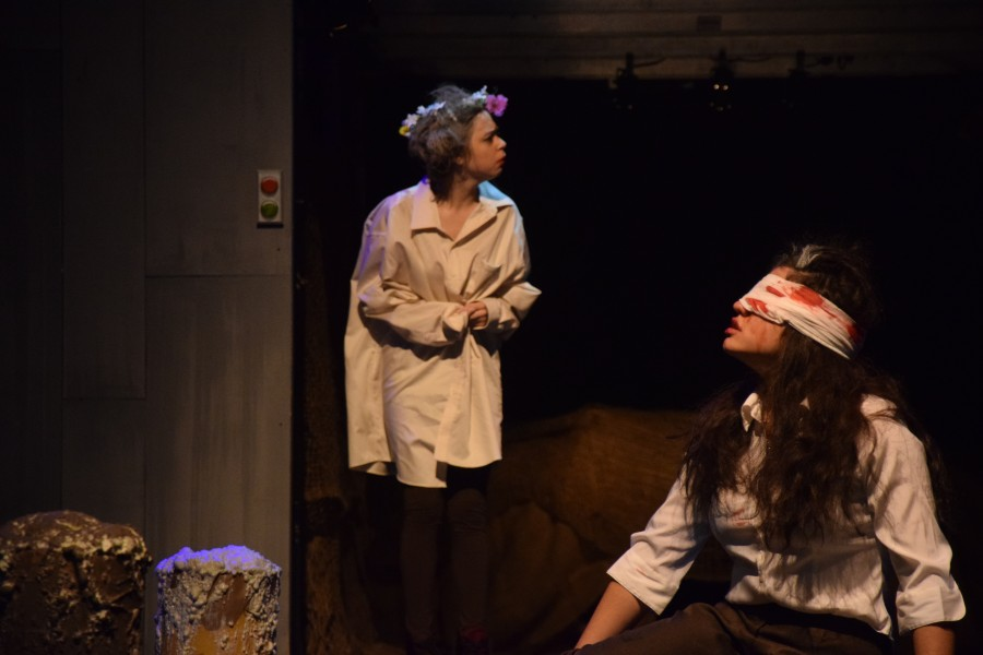 As Lear, played by Sophia Pouzyrev, enters the scene, she encounters Gloucster, played by Maeve Forti, who was blinded.  Sam Klein / Sagamore Staff