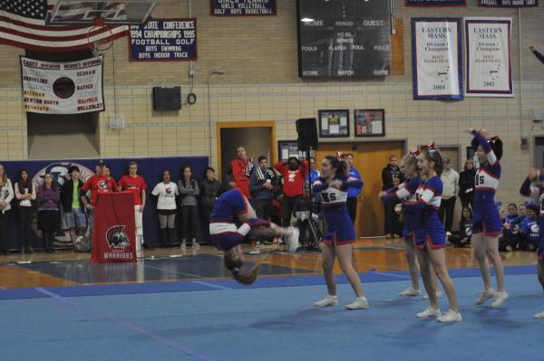Senior and captain Carrie Tucker does a flip during the cheerleading team's performance at the pep rally. Sam Klein / Sagamore staff