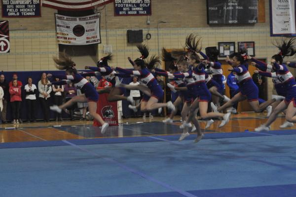 The cheerleading team performs at the pep rally. Sam Klein / Sagamore Staff