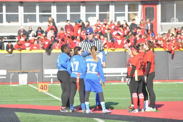 The teams' captains meet with the referee before the coin toss. Sam Klein / Sagamore staff