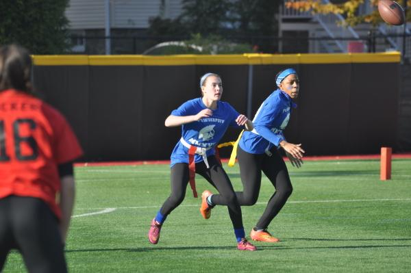 Juniors Emily Ribatt and Patricia Douglas play at Powderpuff. Sam Klein / Sagamore Staff