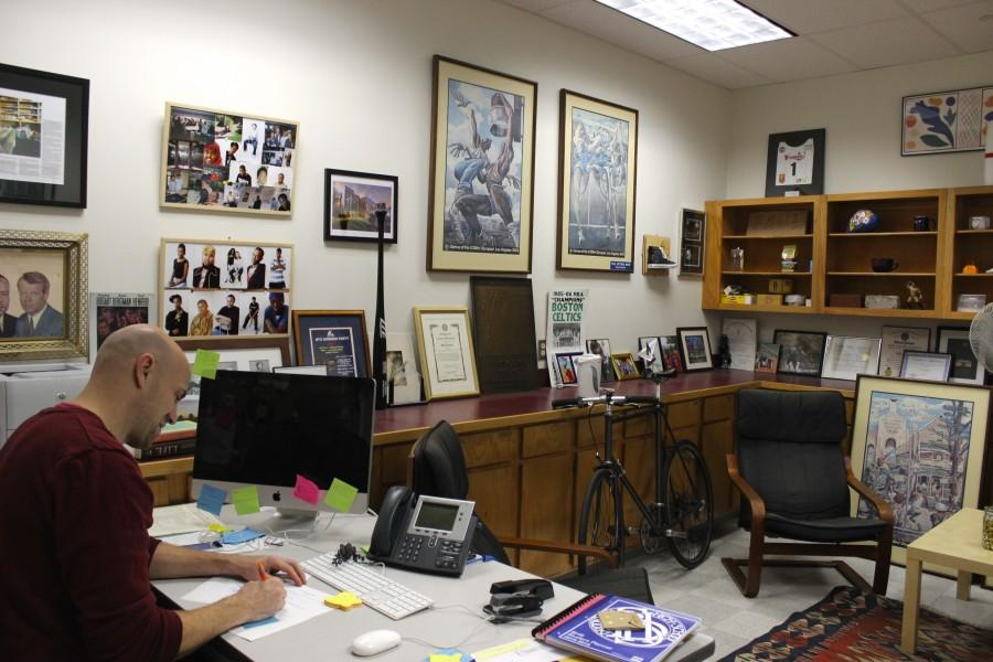 Social worker, Paul Epstein, works in his office.
