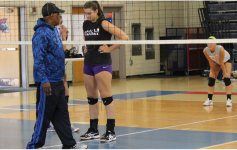 Sophomore Olivia Brown consults head coach James Watson during practice. Brown is one of two returning varsity players, along with senior Neda Morakabati, and is optimistic about the season. Petra Huang for the Sagamore.