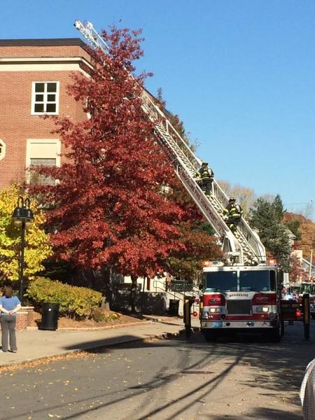 Firefighters use a ladder to ascend to the roof of the Schluntz Gymnasium following a fire alarm that was not a drill. PHOTO BY LINDSAY WISE