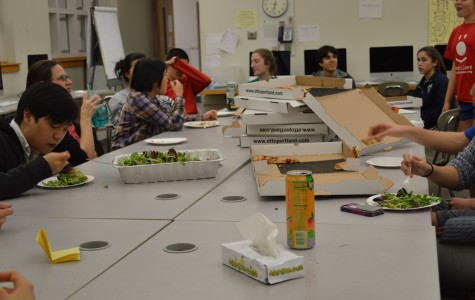 The Sagamore staff eats dinner together on Dec. 9 2015. A generous parent provided a dinner of Otto's pizza, the staff easily went through six boxes. SARA HOGENBOOM/ SAGAMORE STAFF