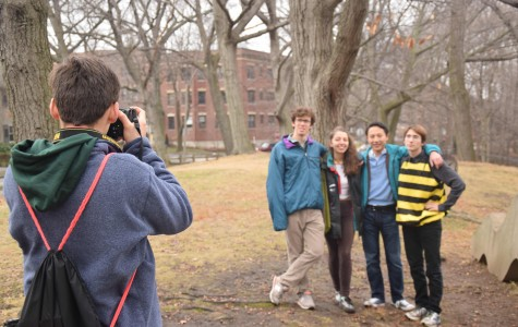 Senior Shams Mohajerani photographs seniors Hal Triedman, Lea Churchill, Kazuto Nishimori and Evan Baker after taking their individual senior pictures in Amory park.