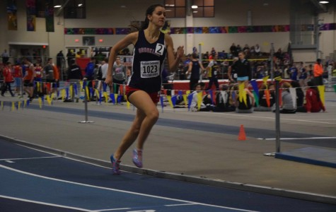 Senior Emma Larrabee runs in the 600 meter. Sam Klein / Sagamore staff.