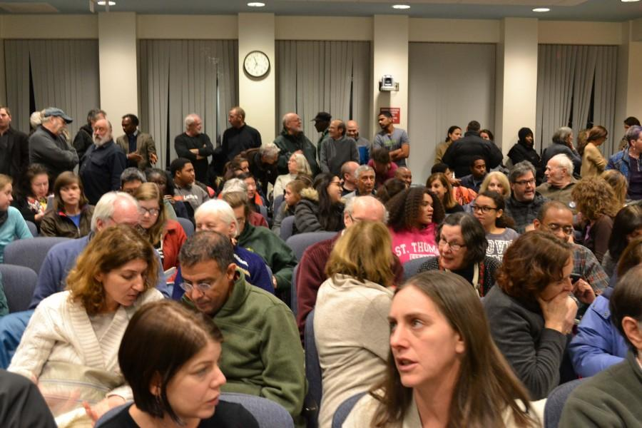 Members of the Brookline community, including people who participated in public comment, talk amongst themselves before the meeting begins. The discussion lasted for approximately two hours with 33 speakers.