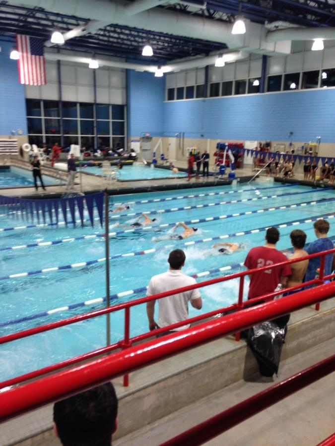 Swimmers+begin+the+100+freestyle.+Ani+Mathison+%2F+Sagamore+Staff