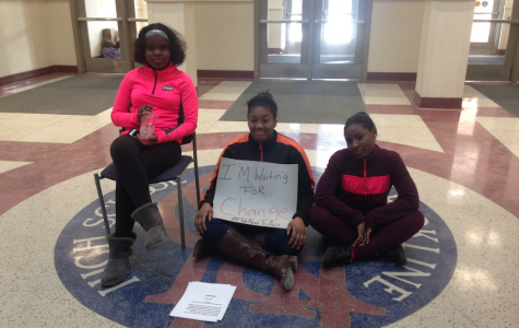 Senior Donnaya Brown sits in protest in the atrium with juniors KeiAntey Gamble and Destiny David during C-block. Photo by Kendall McGowan/Sagamore staff.