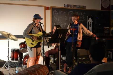 Band director Carolyn Castellano and seniors Jory Cherry and Tristan Geary sing a funny song about dirt at October's Open Mic Night. Kendall McGowan / Sagamore Staff