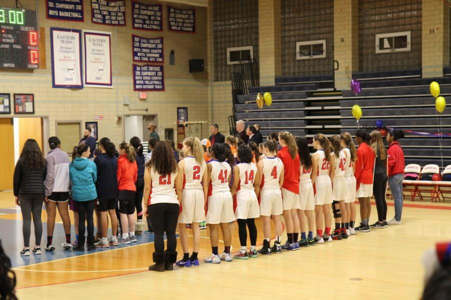 Brookline players stood shoulder to shoulder during the singing of the national anthem. Leon Yang / Sagamore Staff