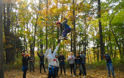 An ACE student flies through the air on a bonding trip that orients students to the new program and faculty.