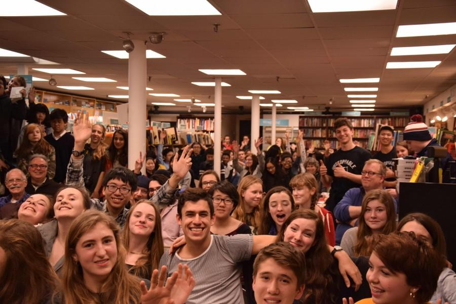 The basement of Brookline Booksmith was filled, forcing people to resort to standing room in addition to the seats.