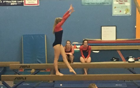 Senior Kaija Bariss performs a routine during a meet this past winter season. Bariss and the rest of the gymnastics team faced many challenges during the season, including the absence of a coach at the beginning of the year, as well as a lack of training facilities. Provided by Kyle Williams.