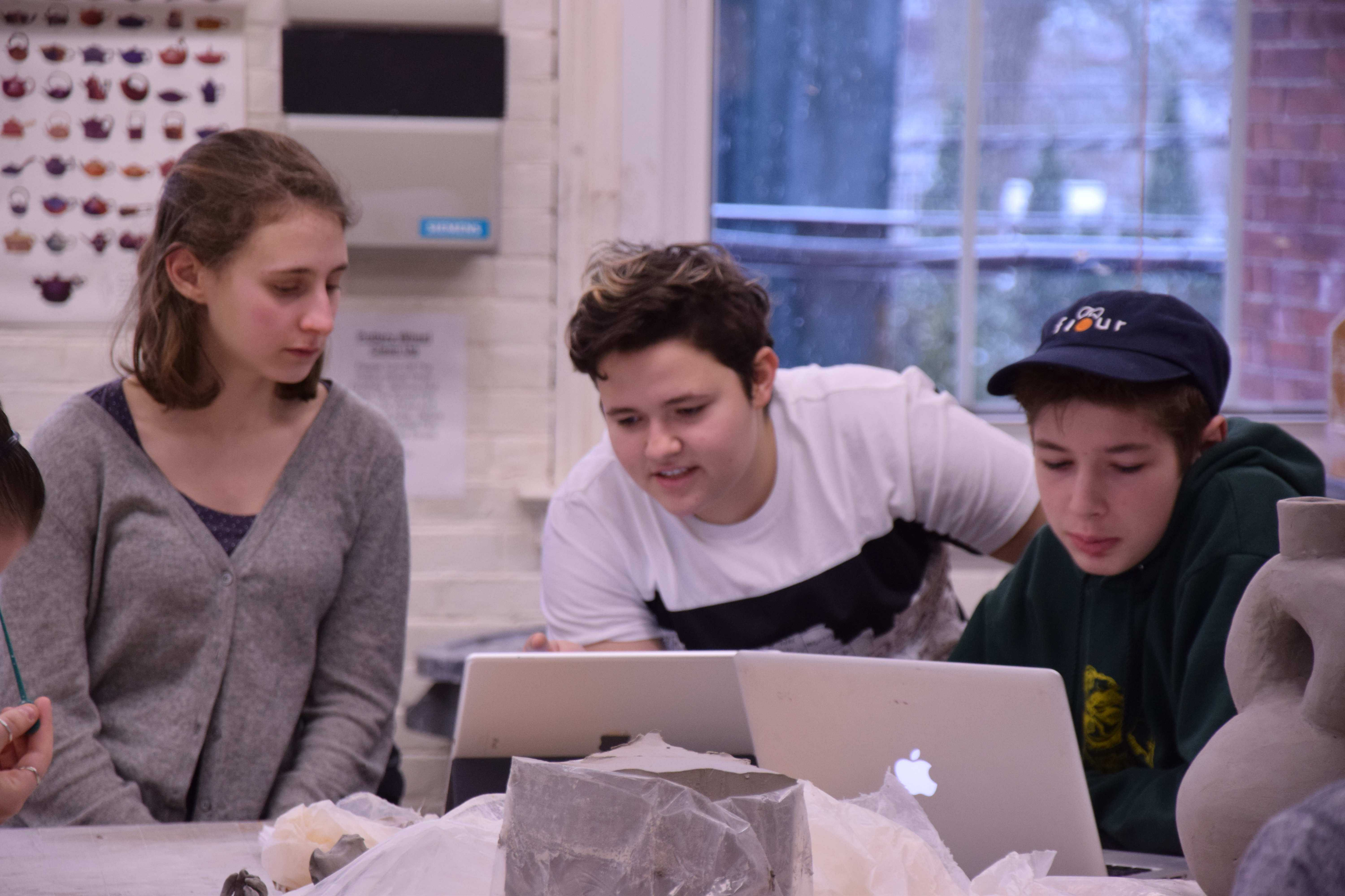 Juniors Alice Foster and Eli Levin and sophomore Christian Gaehde participate in a Z-block ceramics class. SAM KLEIN / SAGAMORE STAFF