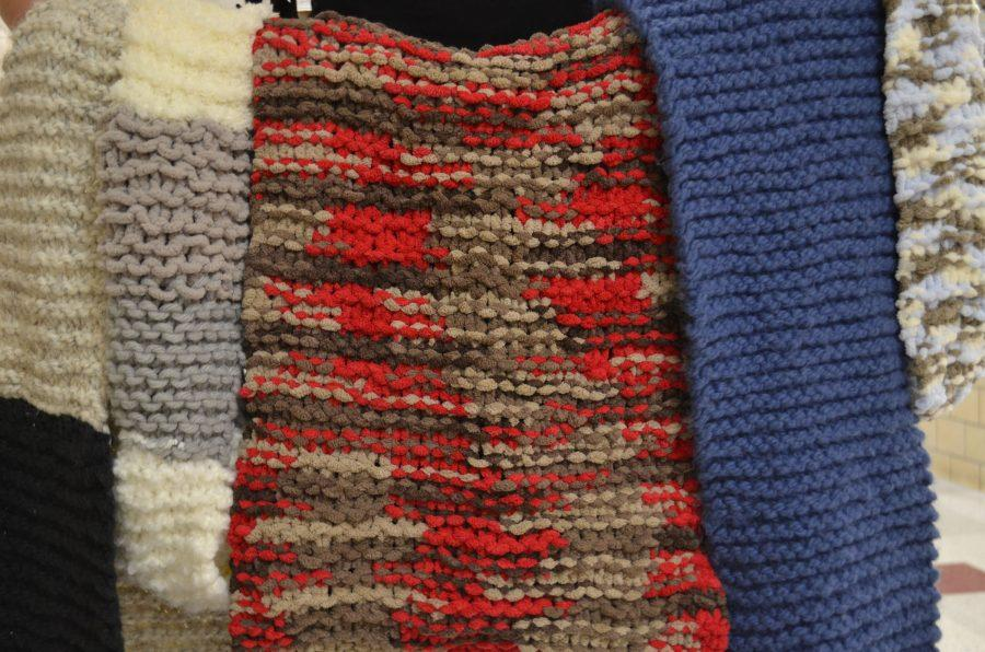 These+scarves%2C+knitted+by+senior+Sydney+Solem%2C+are+sold+for+%2430.+MAYA+MORRIS+%2F+SAGAMORE+STAFF.
