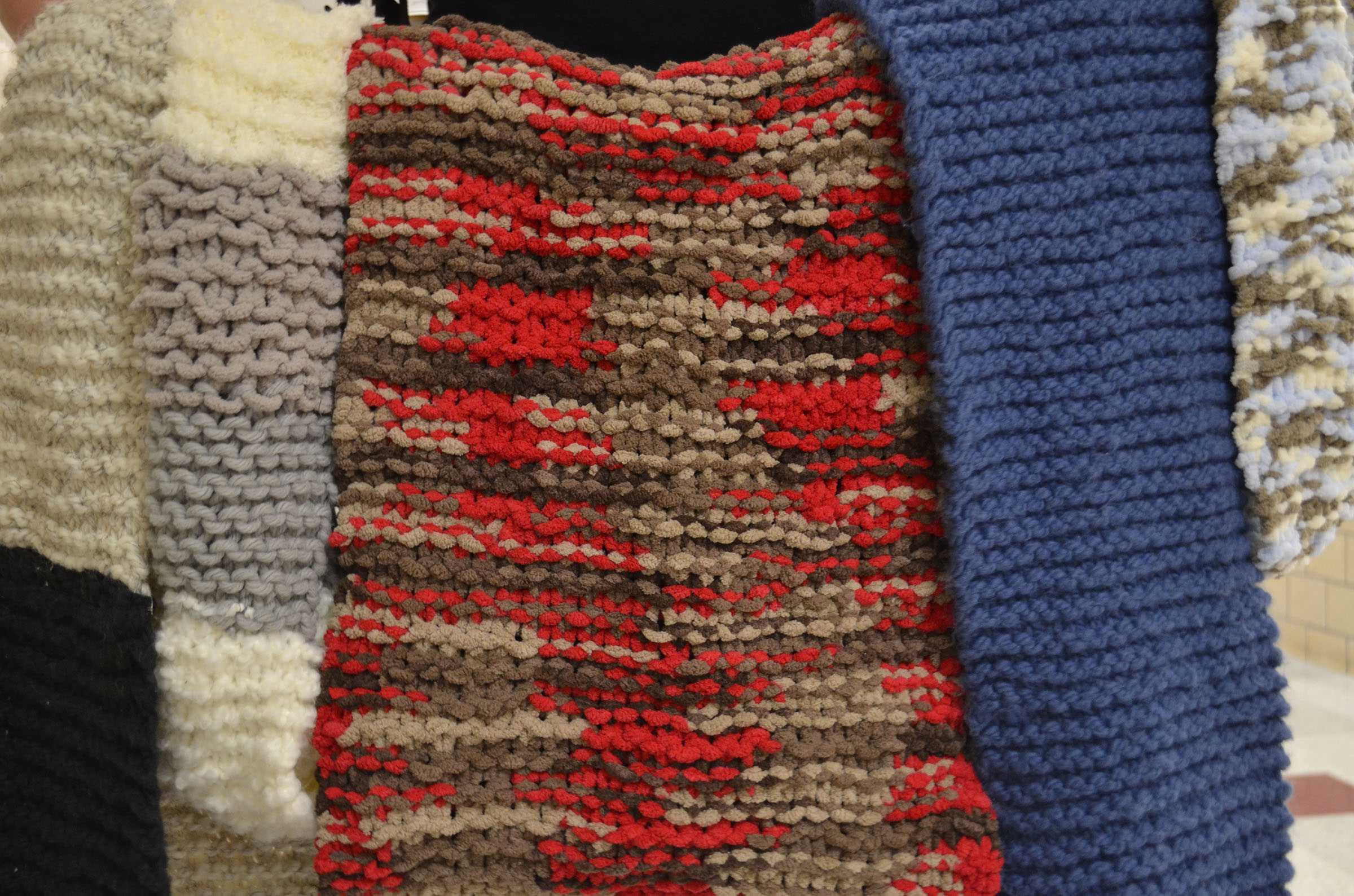 These scarves, knitted by senior Sydney Solem, are sold for $30. MAYA MORRIS / SAGAMORE STAFF.