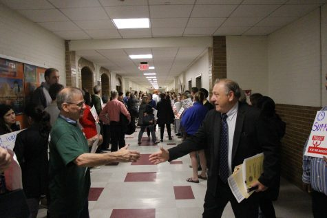 School faculty gather in the hallway outside Town Meeting during the 2015 school year. Leon Yang / Sagamore Staff