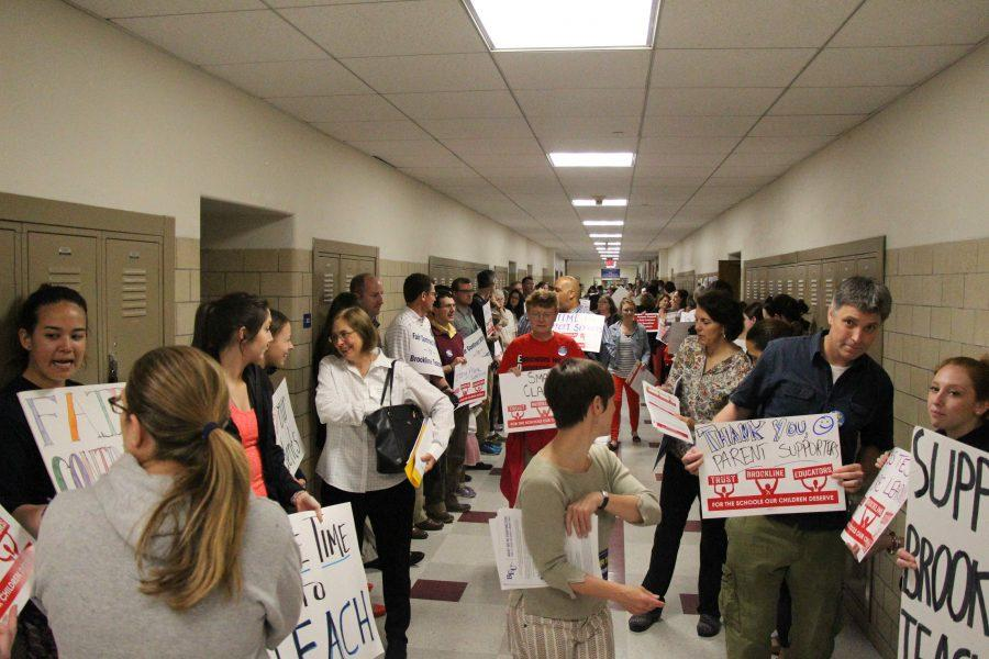 School faculty gather in the hallway outside Town Meeting. Leon Yang / Sagamore Staff