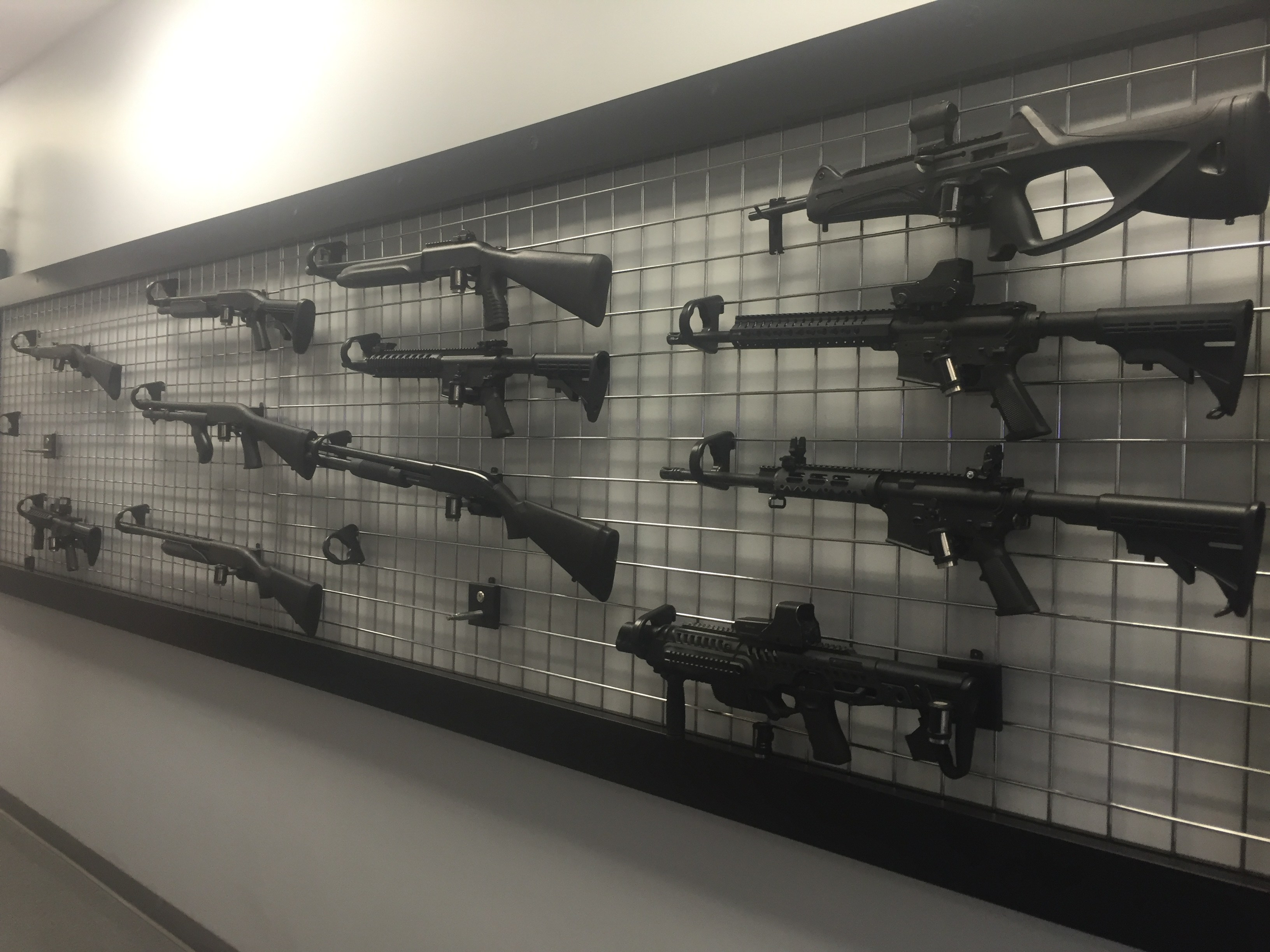 Firearms displayed on the wall in the lobby of Mass Firearms.