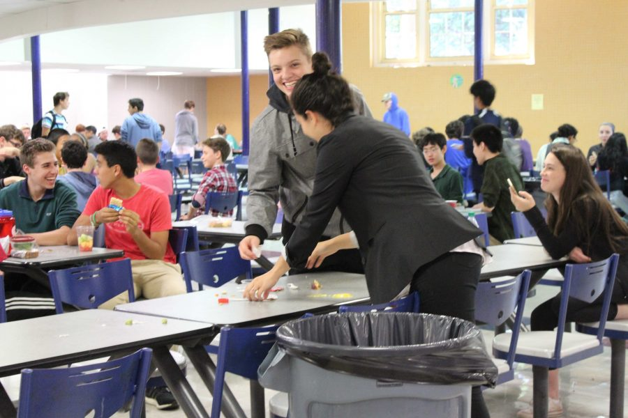 A teacher helps a student clean up in the cafeteria during lunch. Taking part in lunch duty presents an opportunity for faculty members to connect with the student body. Ani Mathison/Sagamore Staff