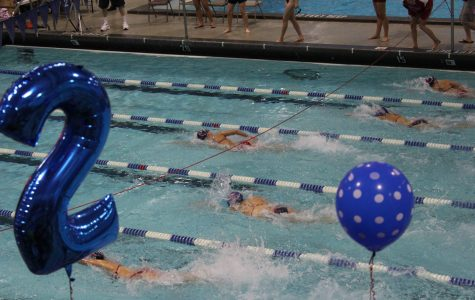 Members of the girls swim and dive team compete during Senior Day. Sam Klein for the Sagamore