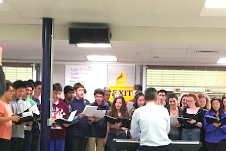 Camerata Choir sings at a vigil on Nov. 15 sponsored by Pax. The vigil also featured guest speakers, including Hajar Delshad. Lauren Mahoney/ Sagamore Staff