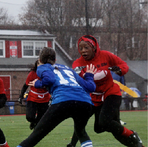 Girls on team red work together to beat team blue and secure a win using techniques and plays they had learned during practices.