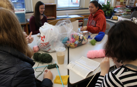 Members of Knitting for a Cause gather during X-block. Club members are currently embarking on their next project, knitting squares to make a blanket for Brookline's homeless. MAYA MORRIS/SAGAMORE STAFF