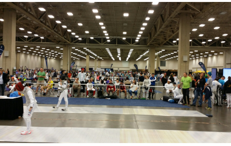 The fencing team prepares for a match. Many of the athletes support each other from the sidelines when they are not fencing. Although it is an individual sport, the overal team score still matters most.