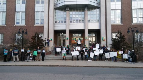 Amnesty International club organizes protest in response to immigration freeze